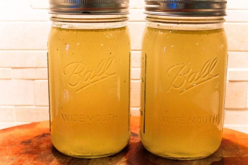 homemade chicken stock in a bottle