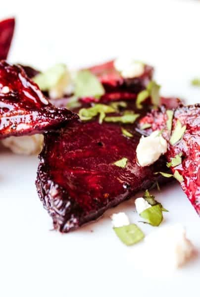 Smoked beets recipe featuring fresh beets smoked indirectly on the grill & topped with a balsamic glaze, goat cheese, & fresh herbs. Simple ingredients, low involvement & great taste. #beets