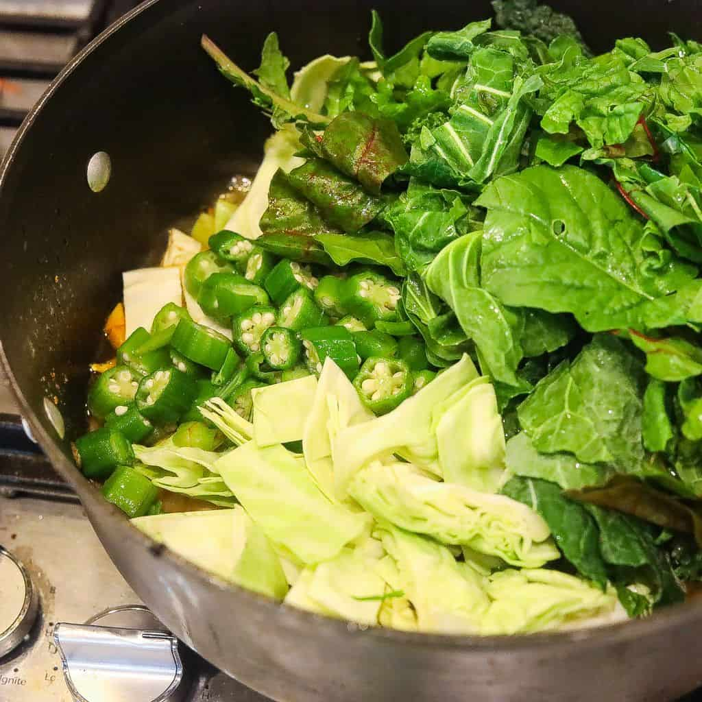greens, cabbage, okra in large pot cooking
