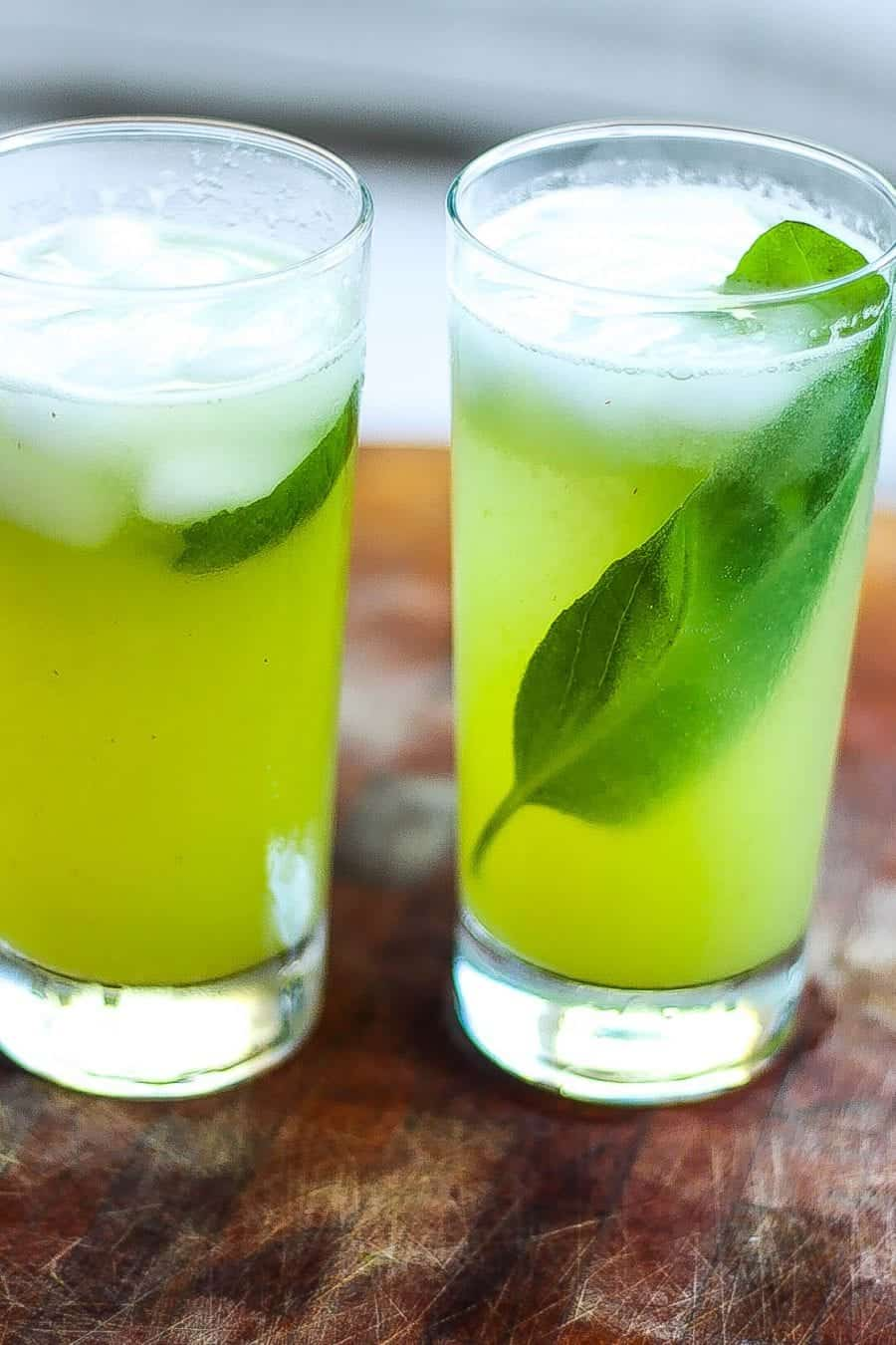 Refreshing recipe for homemade sparkling melon cucumber soda featuring ripe melon and cucumbers elevated with citrus lime juice and fresh basil.