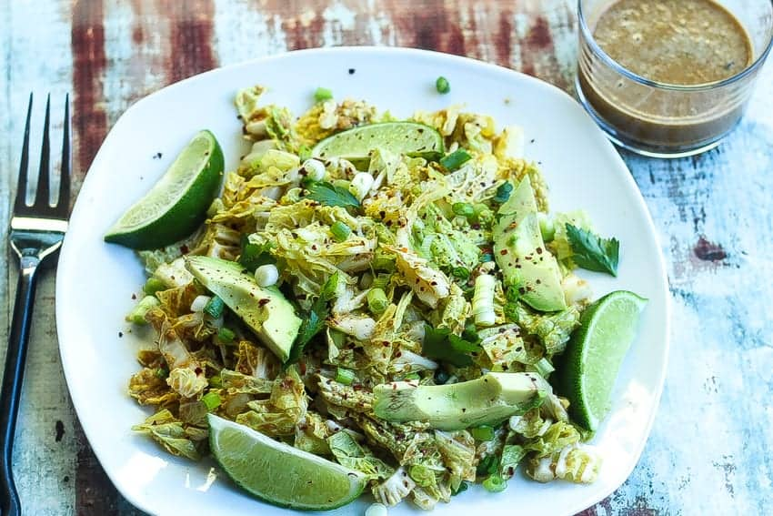 napa cabbage salad on a plate with peanut sauce on the side #salad www.foodfidelity.com