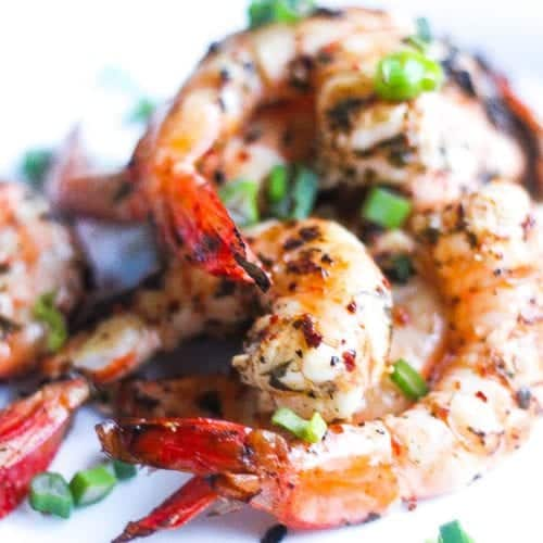 grilled piri piri shrimp on a plate with piri piri spices