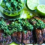 grilled portobello mushrooms on a plate with spinach chimichurri #mushrooms #portobellos www.foodfidelity.com