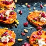 sweet potato steak rounds topped with goat cheese,pistachios, and wine soaked cranberries #sweetpotato #vegetarian www.foodfidelity.com