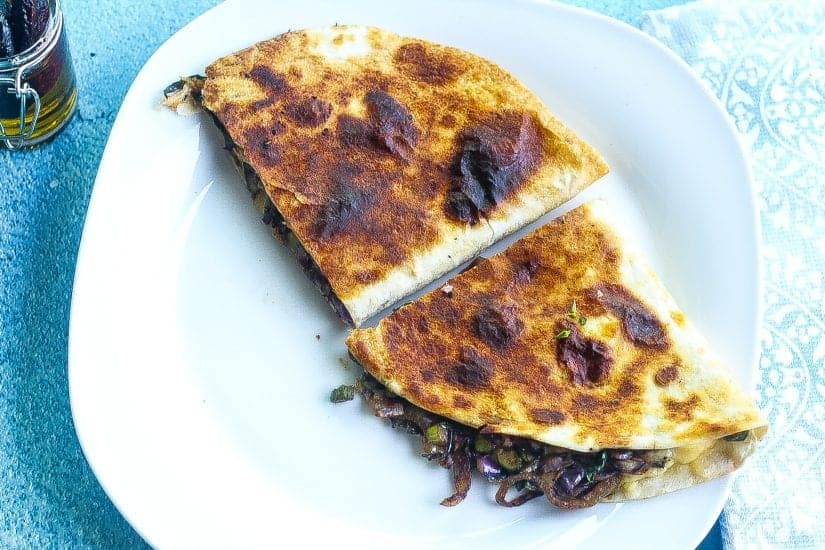 brussels sprouts vegetarian quesadilla stacked on a plate #quesadillas #brusselssprouts www.foodfidelity.com