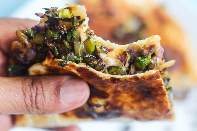 brussels sprouts quesadillas stacked on a plate #quesadillas #brusselssprouts www.foodfidelity.com