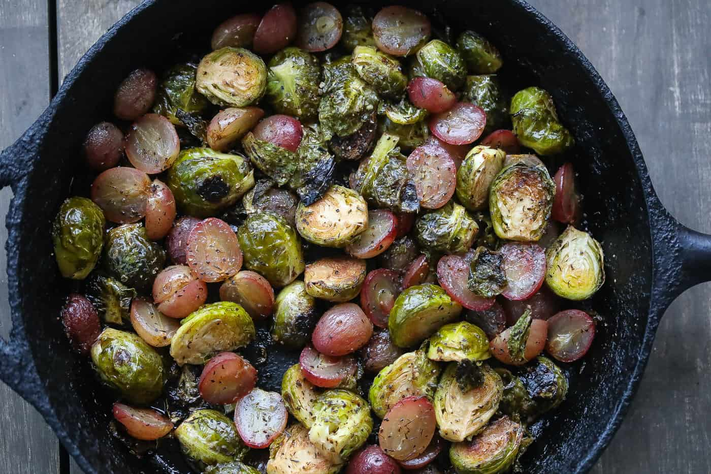 roasted brussel sprouts and grapes in a skillet