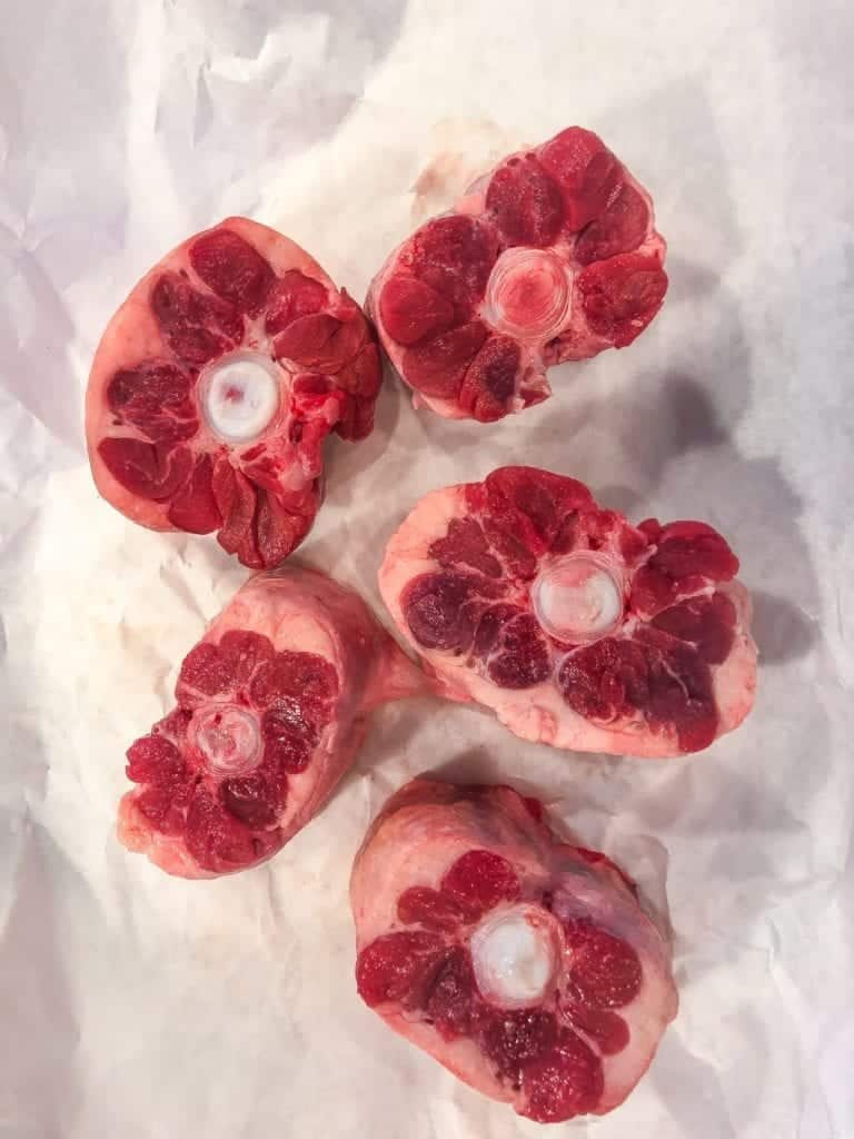 raw beef oxtails on white butcher paper