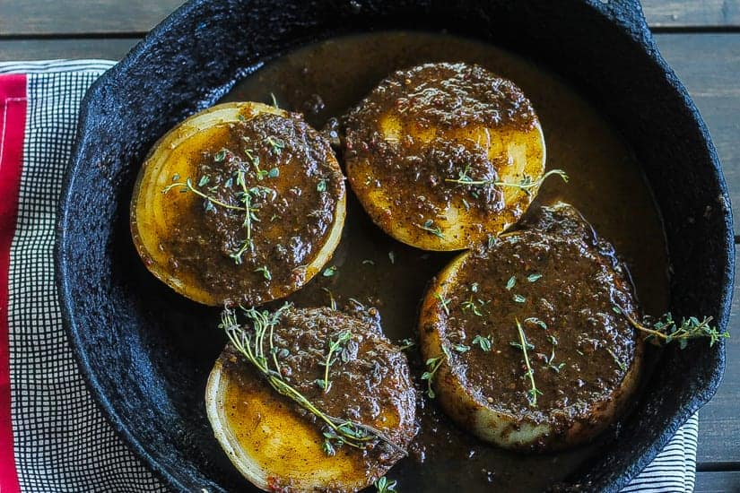jerk marinated roasted onions topped with fresh thyme