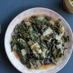 wine braised collard greens on a plate