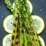 Grilled asparagus on a bed of lemon slices
