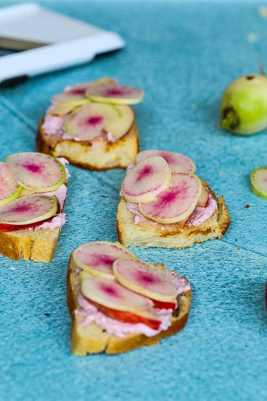 watermelon radish toast with peaches and cream cheese