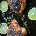 Pan Roasted Jerk Chicken Thighs in a pan