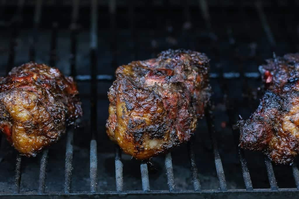 jerk oxtails smoking on the grill
