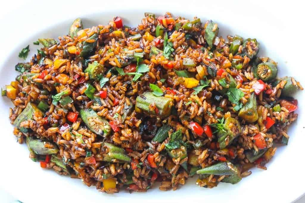 vegetable fried rice with okra on a white plate