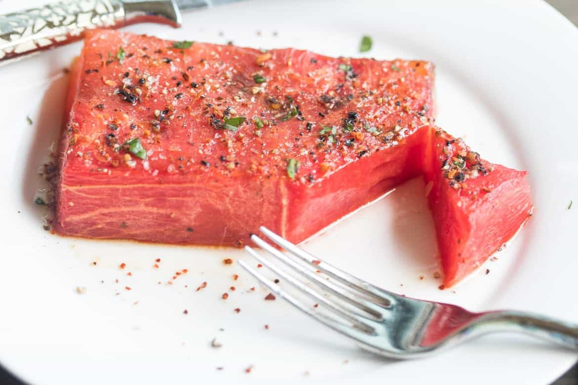 roasted watermelon steak on a plate.
