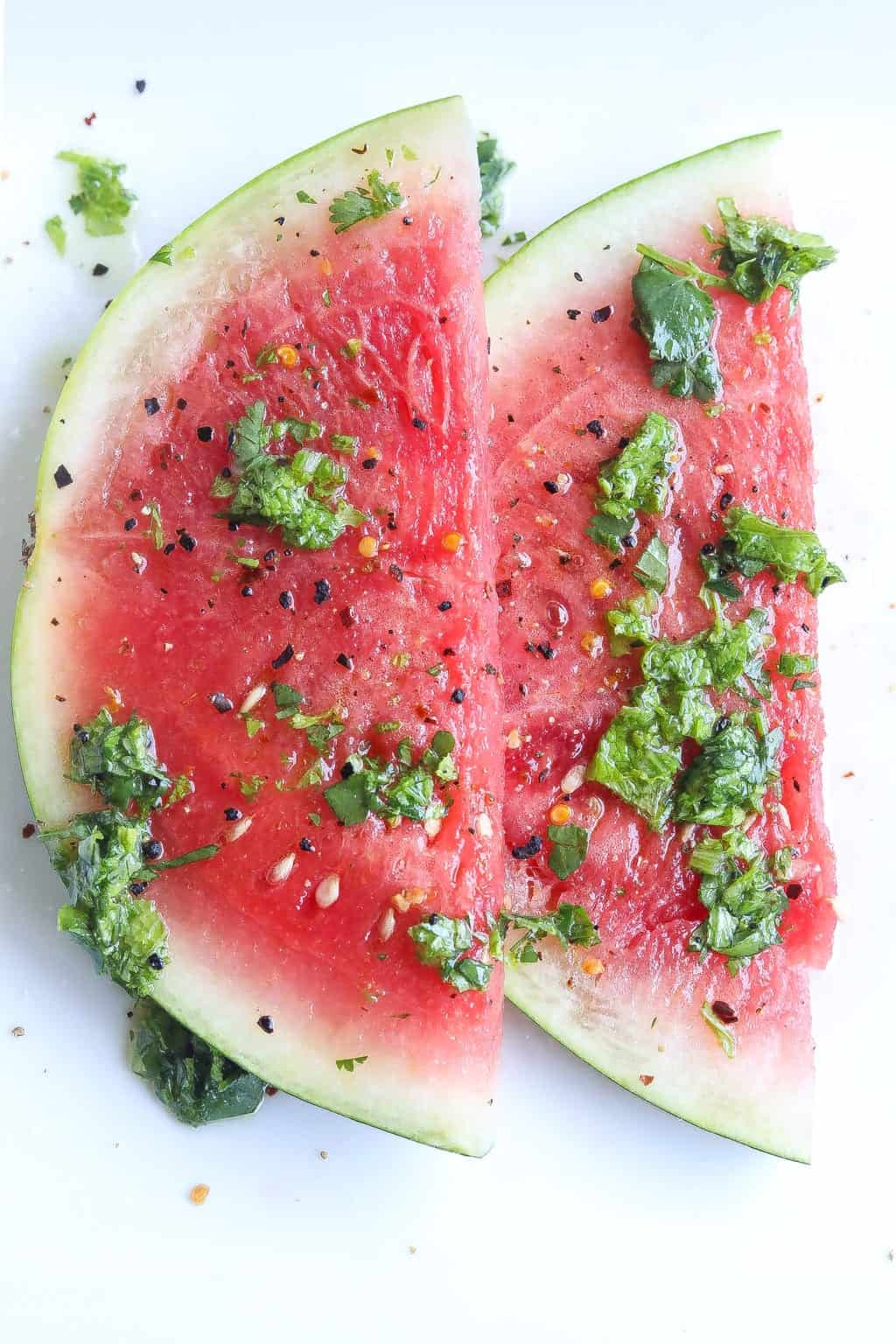 watermelon salad on a plate topped with mustard green chimichurri sauce