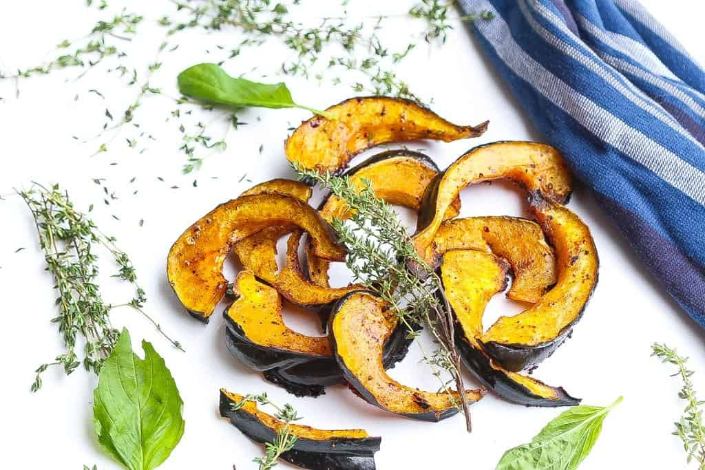 roasted acorn squash slices glazed with chili and honey topped with thyme