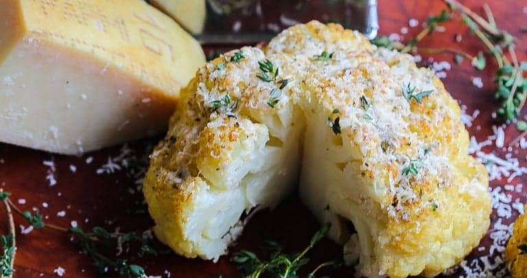 whole roasted cauliflower topped with parmigiano reggiano cheese.