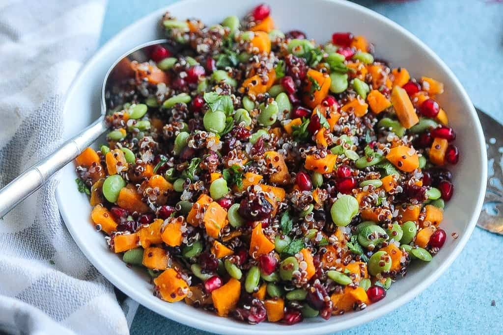 easy vegan quinoa salad with pomegranate and vegetables
