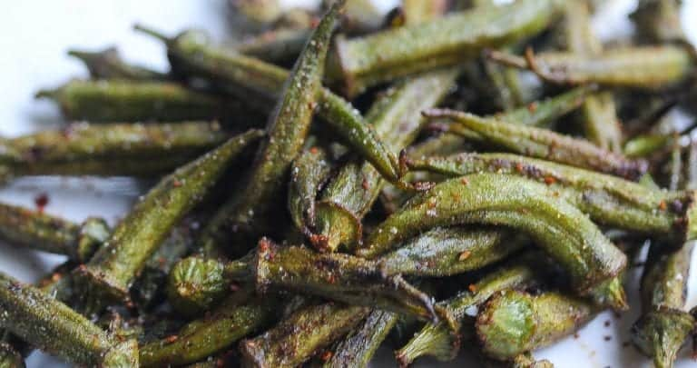 roasted okra with seasoning on a white plate