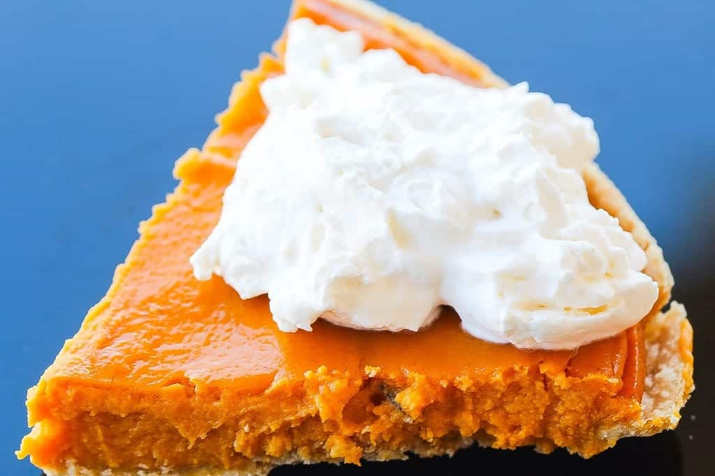 Southern sweet potato pie with cream on a plate