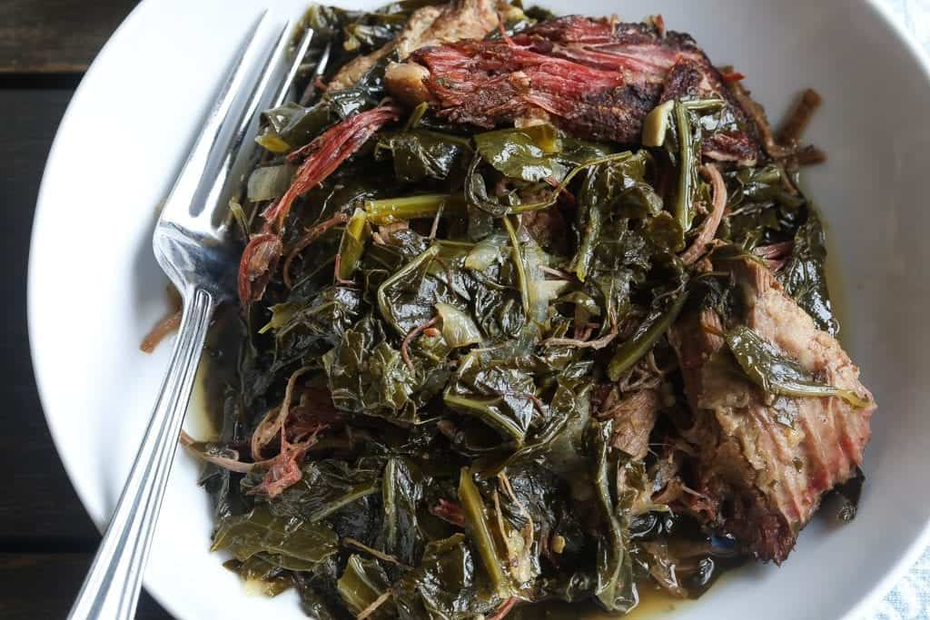 collard greens with brisket in bowl