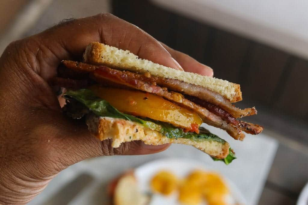 blt sandwich held in a hand