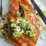 salmon steak topped with green onions vinaigrette