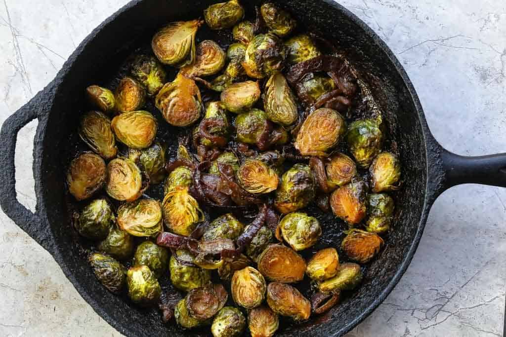 braised brussel sprouts in a skillet