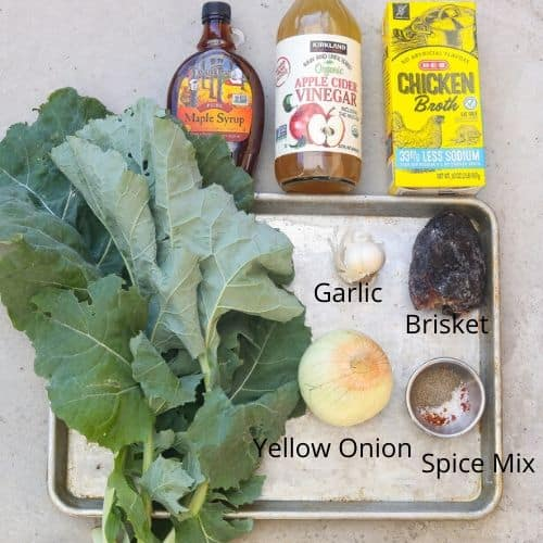 collard greens ingredients laid out on a tray