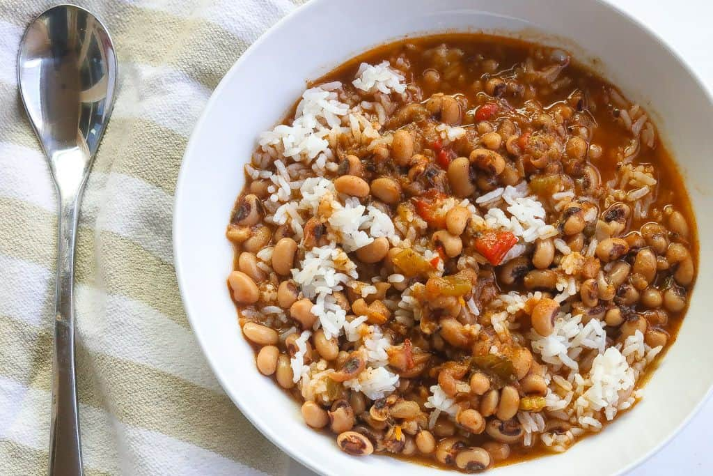 white bowl of black eyed peas and rice