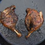 duck confit in skillet cooking