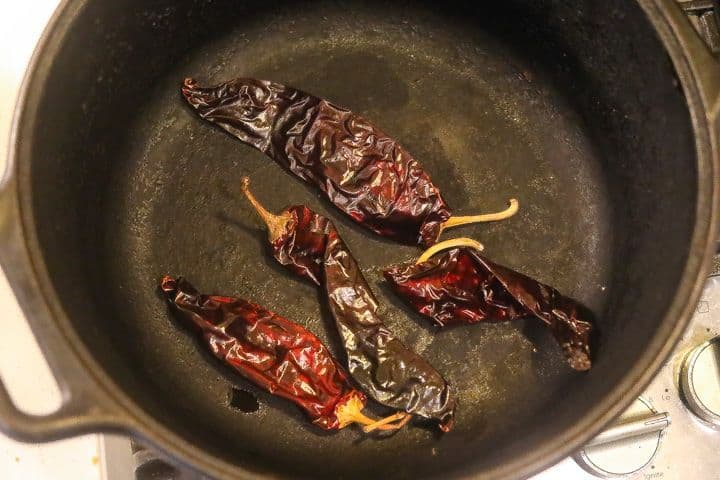 dried chilis roasting in pan
