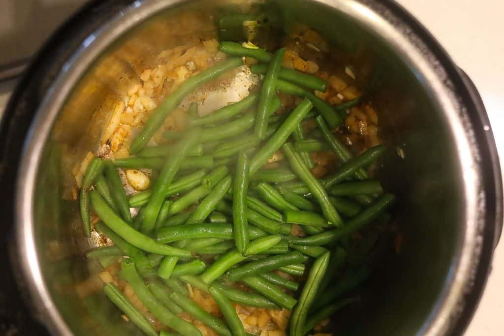 green beans cooking in pan