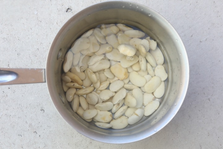 lima beans in pot of water
