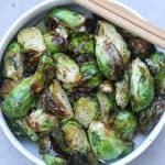 fried brussel sprouts in a bowl with chopsticks