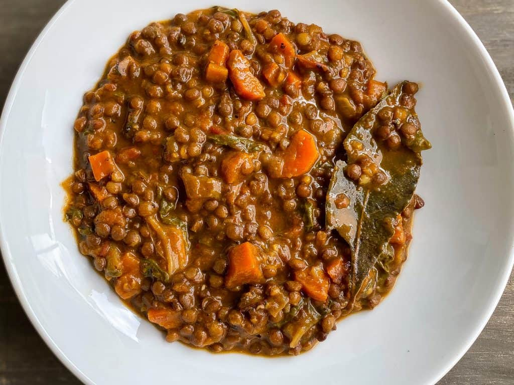 lentil stew in white bowl