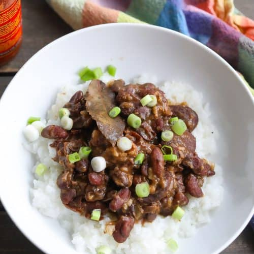 red beans and rice with sausage in a white bowl