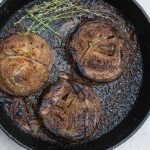 roasted onions in a skillet
