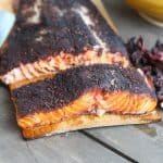 cedar plank grilled salmon on a table