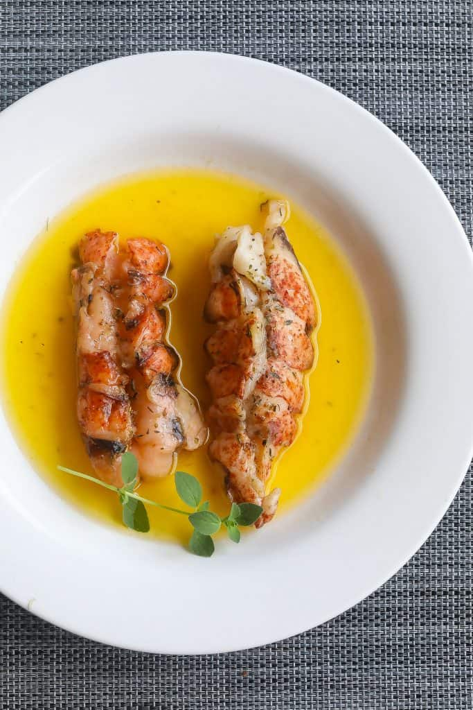 lobster and butter in white bowl