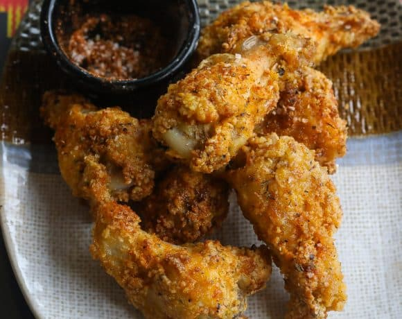 crispy chicken wings on a plate with dry spices