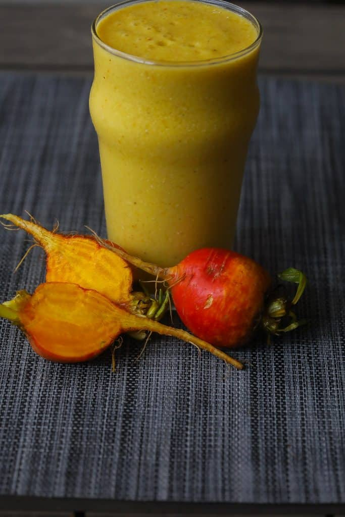 smoothie in a glass with golden beets