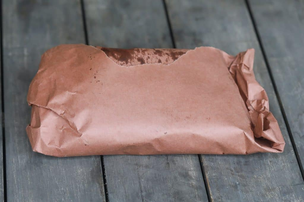 cooked meat wrapped in butcher paper
