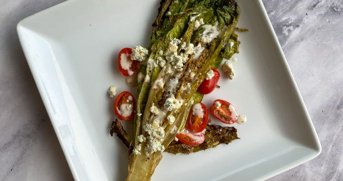 romaine salad on a white plate
