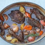 beef pot roast in a dutch with carrots and potatoes