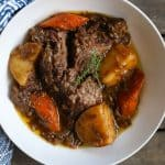 beef pot roast in a bowl with carrots and potatoes