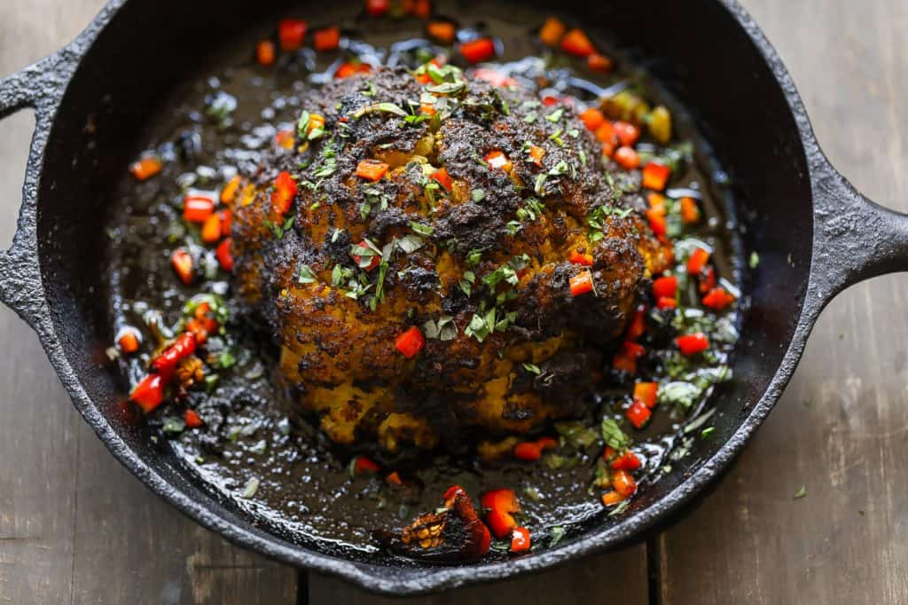 whole roasted cauliflower in cast-iron skillet