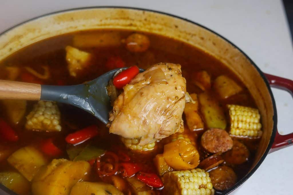 stew cooking in red pot